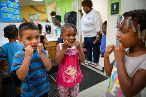 Photo: Rachel S. O'Hara /Sarasota Herald-TribuneFelix Perlata, 4, Alani Waiters, 5, and Cymia Martin, 4, floss their teeth before heading back to class at Morton Clark Head Start preschool in Bradenton, Fla.