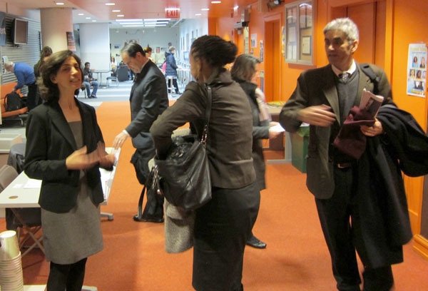 Marilyn Serafini, left, of the Alliance for Health Reform greets panelists arriving for Chicago chapter event.