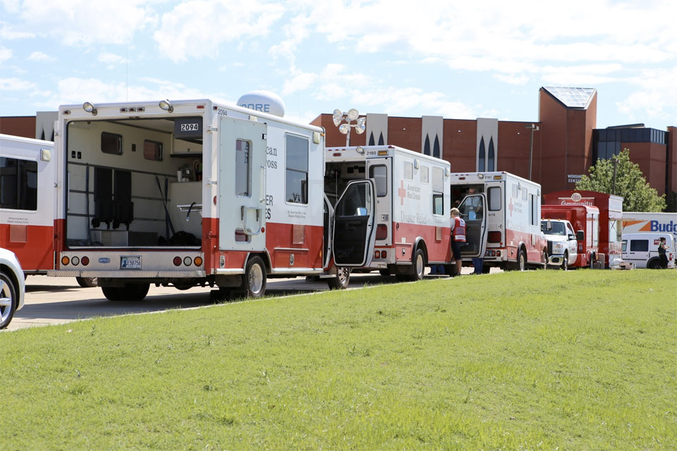 Ambulances line up in Moore, Okla., following a deadly tornado in May 2013.