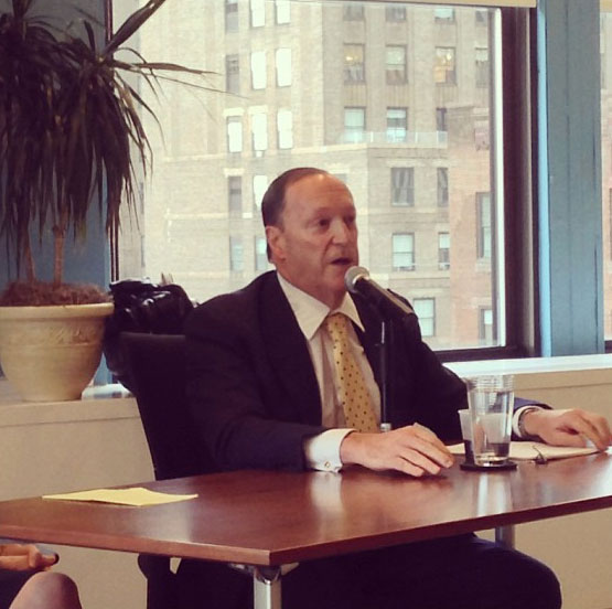 Steve Brill speaks about the cost of health care at a meeting of the New York chapter of AHCJ.