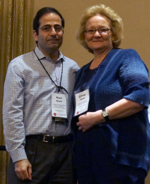 Photo: Len BruzzeseBillings Gazette reporter Cindy Uken accepted her award from AHCJ president Karl Stark at Health Journalism 2014. Uken won a Award for Excellence in Health Care Journalism for her in-depth reporting on suicide in Montana.