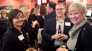 Photo: Phil Galewitz/Kaiser Health NewsJulie Appleby (left), of Kaiser Health News, and  Laurie McGinley, of The Washington Post, with a representative of Bristol-Myers Squibb at the Washington, D.C., AHCJ chapter event on March 18.