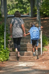 Photo: CDC Public Health Image Library/Amanda MillsAn African-American boy is seen walking with a teacher in Atlanta.