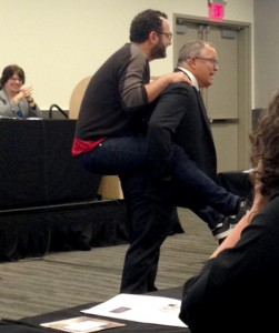 Photo: Tara BannowColin Milner, CEO of the International Council on Active Aging and publisher of the Journal of Active Aging, carried an audience member on his back to demonstrate the effects of carrying extra weight.