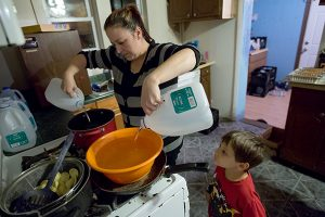 Photo: Ryan Garza, USA Today NetworkLee Anne Walters of Flint, Mich., pours gallons of bottled water into a bucket and pan to warm up for her twin sons to take a weekly bath. Her son, Gavin, 4, looking on, has been diagnosed with lead poisoning. The photograph ran as part of USA Today's investigation into lead levels nationwide, beyond the crisis in the Detroit suburb.