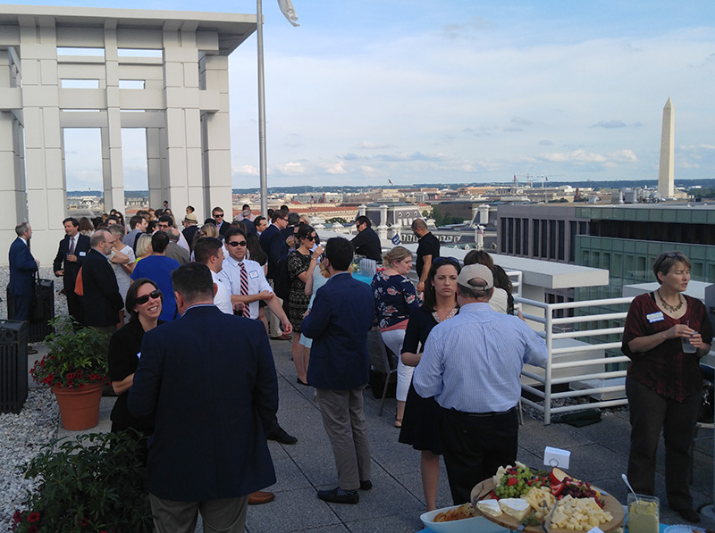 Photo: Phil GalewitzHealth journalists and communications professionals from several health organizations attended an informal rooftop gathering in Washington, D.C., on June 2.
