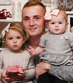 Vadim Anatoliyevich Kondratyuk and his daughters in an undated family photo before his death after complications from a dental infection.