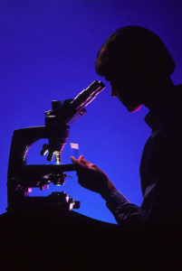 scientist-with-microscope