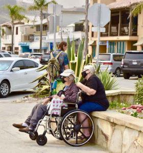 Elderly couple wearing masks
