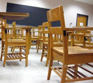 School desks in an empty classroom