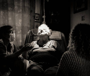 Elderly woman and shielded caregiver