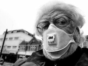 Older man wearing mask in UK