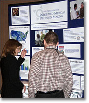 Attendees at Health Journalism 2007 browse exhibitors' booths.