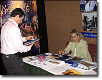 An attendee visits exhibitor booths at Health Journalism 2007.