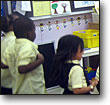 Children exercise in the classroom as part of a school-based health program in the Bronx, New York.