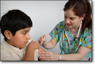 A nurse vaccinates a child in this CDC photo.
