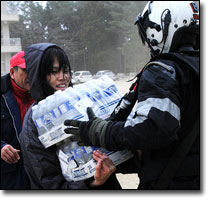 Sailor provides food and water to Japanese citizens during relief efforts. Photo: Official U.S. Navy Imagery via Flickr